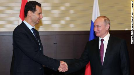 Russian President Vladimir Putin shakes hands with his Syrian counterpart Bashar al-Assad during their meeting in Sochi Thursday.