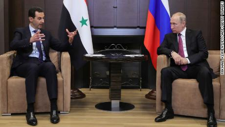 Russian President Vladimir Putin  speaks with his Syrian counterpart Bashar al-Assad.