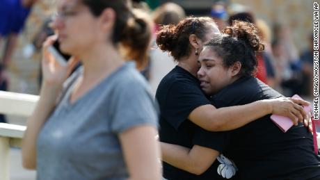 Santa Fe High School junior Guadalupe Sanchez, 16, cries in the arms of her mother, Elida Sanchez, after reuniting with her at a meeting point at a nearby fitness center after Friday's shooting.