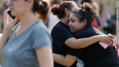 Santa Fe High School junior Guadalupe Sanchez, 16, cries in the arms of her mother, Elida Sanchez, after reuniting with her at a meeting point at a nearby Alamo Gym fitness center following a shooting at Santa Fe High School in Santa Fe, Texas, on Friday, May 18, 2018. (Michael Ciaglo/Houston Chronicle via AP)