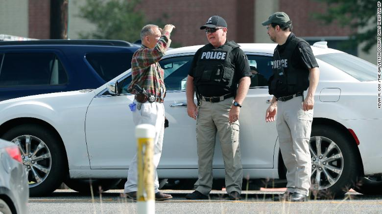Police officers work a checkpoint in front of Santa Fe High School in response to the shooting.