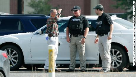Police officers work a check point in front of Santa Fe High School in response to a shooting at the school on Friday, May 18, 2018, in Santa Fe, Texas. (Kevin M. Cox /The Galveston County Daily News via AP)