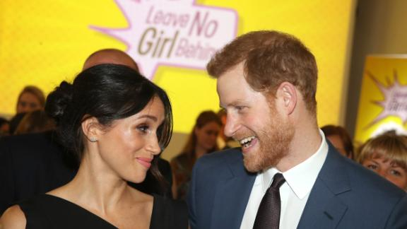 Meghan Markle and Prince Harry attend the Women