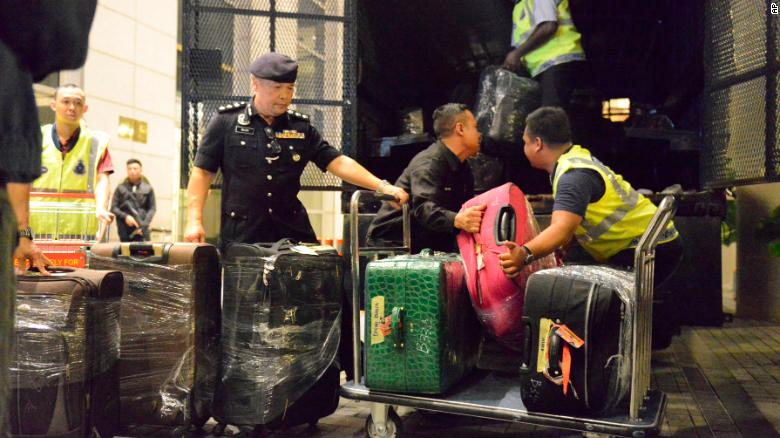 Malaysian police confiscated a few hundred designer handbags, cash, jewelry and other valuables as part of an investigation into former Prime Minister Najib Razak.