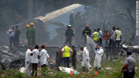 "TOPSHOT - Emergency personnel works at the site of the accident after a Cubana de Aviacion aircraft crashed after taking off from Havana's Jose Marti airport on May 18, 2018. - A Cuban state airways passenger plane with 113 people on board crashed on shortly after taking off from Havana's airport, state media reported. The Boeing 737 operated by Cubana de Aviacion crashed ""near the international airport,"" state agency Prensa Latina reported. Airport sources said the jetliner was heading from the capital to the eastern city of Holguin. (Photo by Yamil LAGE / AFP)        (Photo credit should read YAMIL LAGE/AFP/Getty Images)"