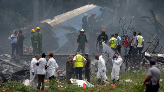 TOPSHOT - Emergency personnel works at the site of the accident after a Cubana de Aviacion aircraft crashed after taking off from Havana