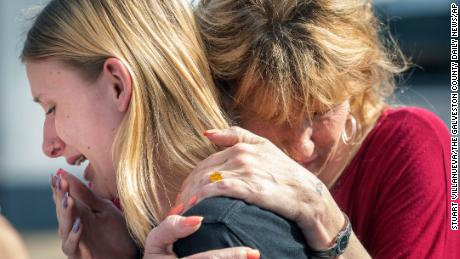 Santa Fe High School student Dakota Shrader is comforted by her mother Susan Davidson following a shooting at the school on Friday, May 18, 2018.