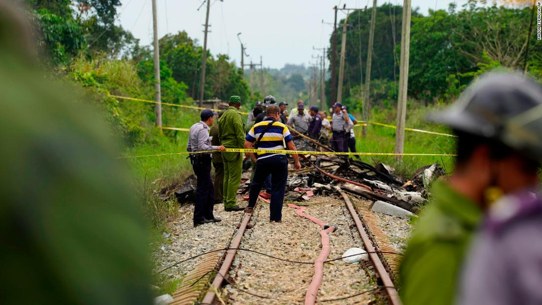 Emergency teams work at the site of the crash on May 18. The flight was heading from Havana to the eastern Cuban city of Holguin when it plummeted into the agricultural area on the outskirts of the capital.