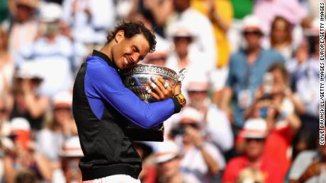 PARIS, FRANCE - JUNE 11: Rafael Nadal of Spain celebrates victory with the trophy following the mens singles final against Stan Wawrinka of Switzerland on day fifteen of the 2017 French Open at Roland Garros on June 11, 2017 in Paris, France. (Photo by Clive Brunskill/Getty Images)