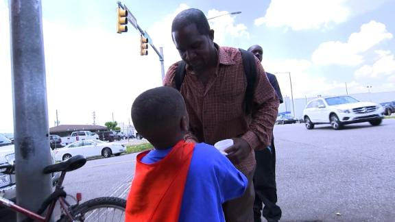 Austin Perine, hands out meals outside the Firehouse Ministries shelter.
