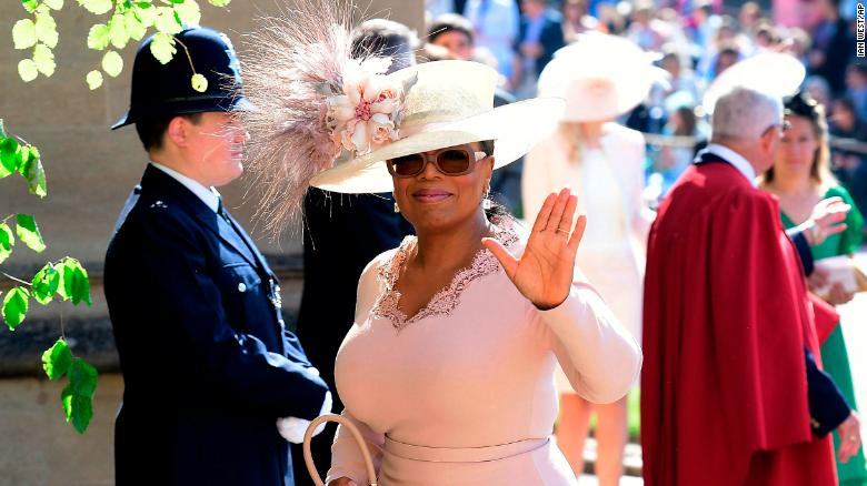 Oprah Winfrey waves as she arrives on Saturday.