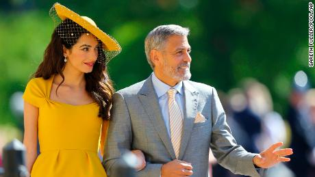 Amal Clooney and George Clooney arrived looking like they go to royal weddings every week.