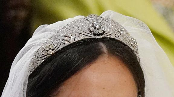 The veil is held in place by Queen Mary's diamond bandeau tiara, on loan from the Queen. Crafted in 1932, the diamond bandeau features a center brooch dating from 1893.