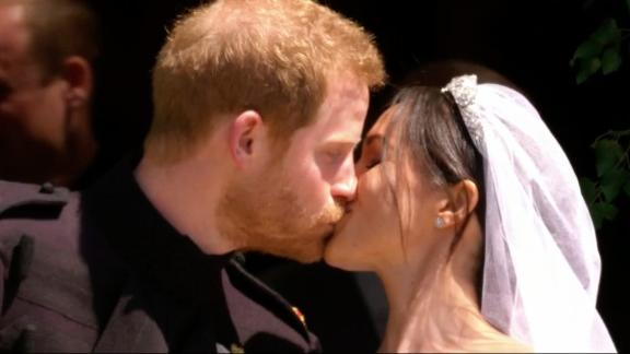 In this frame from video, Britain's Prince Harry and Meghan Markle kiss after their wedding ceremony at St. George's Chapel in Windsor Castle in Windsor, near London, England, Saturday, May 19, 2018.  (UK Pool via AP)