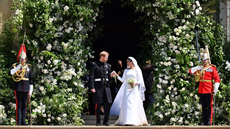 Prince Harry and Meghan Markle leave the chapel after their wedding ceremony.