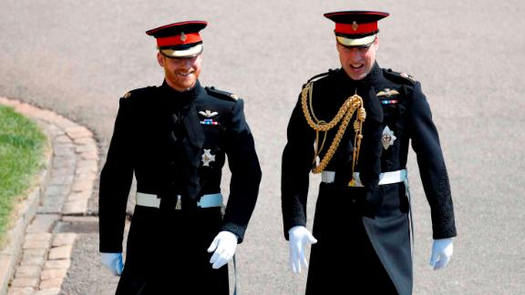 Britain's Prince Harry (L), Duke of Sussex, arrives with his best man Prince William, Duke of Cambridge (R), at St George's Chapel, Windsor Castle, in Windsor, on May 19, 2018 for his wedding ceremony to marry US actress Meghan Markle. (Photo by Odd ANDERSEN / POOL / AFP)        (Photo credit should read ODD ANDERSEN/AFP/Getty Images)
