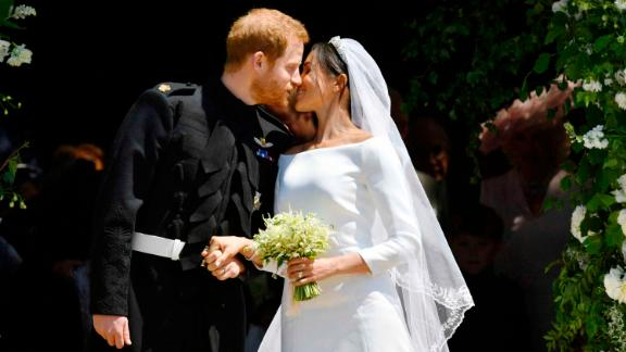 Prince Harry and Meghan Markle kiss on the steps of St George's Chapel in Windsor Castle after their wedding in Windsor, near London, England, Saturday, May 19, 2018. (Ben Birchhall/pool photo via AP)