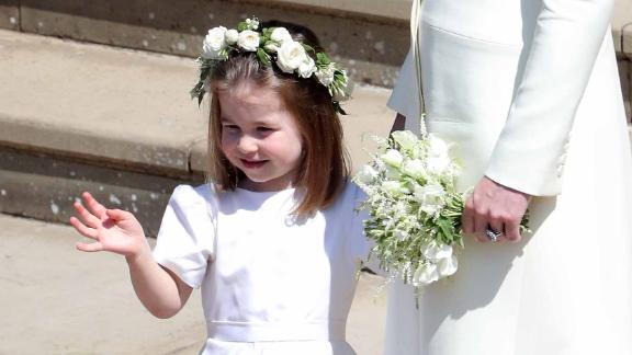 Princess Charlotte waves after the wedding.