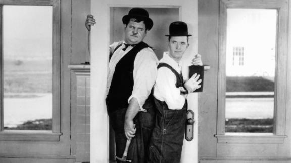 """Stan Laurel, right, and Oliver Hardy, left, successfully moved from the silent films of the 1920s to movies with sound in the '30s because their comedy style was so visual. """"We're not talking comedians,"""" Laurel recalled during a 1957 interview. """"We only said enough to motivate what we were doing."""" """"The moment Laurel and Hardy came together to work as a team was a gift from the comedy gods,"""" said filmmaker Robert Weide."""