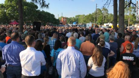 Families gathered for a vigil in Santa Fe, Texas, on Friday, May 18, the evening of a shooting at Santa Fe High School that killed 10.