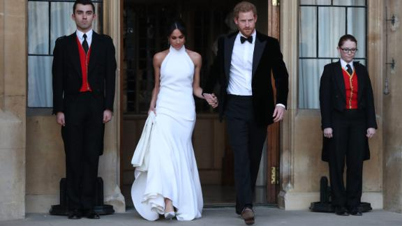 The newly married Duke and Duchess of Sussex, Meghan Markle and Prince Harry, leave Windsor Castle for an evening reception.
