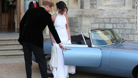 Royal wedding. The newly married Duke and Duchess of Sussex, Meghan Markle and Prince Harry, leaving Windsor Castle after their wedding to attend an evening reception at Frogmore House, hosted by the Prince of Wales. Picture date: Saturday May 19, 2018. See PA story ROYAL Wedding. Photo credit should read: Steve Parsons/PA Wire URN:36595583