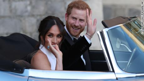 Royal wedding. The newly married Duke and Duchess of Sussex, Meghan Markle and Prince Harry, leaving Windsor Castle after their wedding to attend an evening reception at Frogmore House, hosted by the Prince of Wales. Picture date: Saturday May 19, 2018. See PA story ROYAL Wedding. Photo credit should read: Steve Parsons/PA Wire URN:36595597