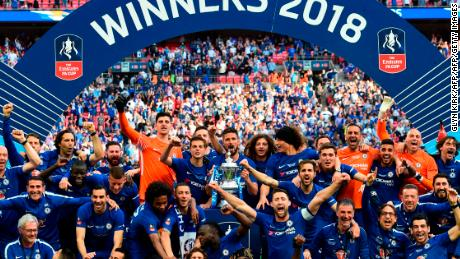Chelsea players celebrate with the trophy after a 1-0 victory over Manchester United in FA Cup final at Wembley.