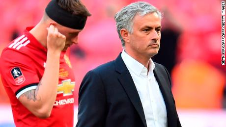 Manchester United's Portuguese manager Jose Mourinho and defender Phil Jones cut dejected figures after the final defeat at Wembley.