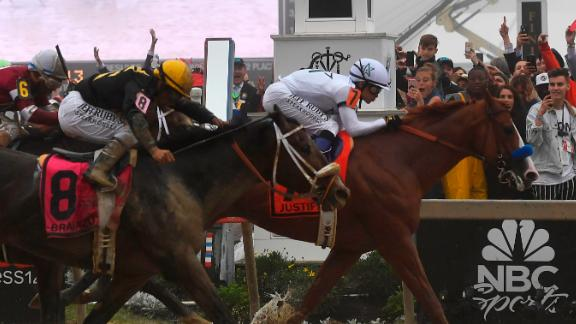 Justify beats Bravazo to the finish line by a half-length in Saturday