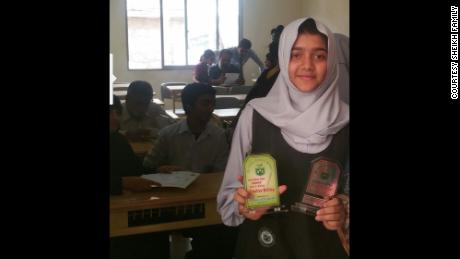 Sabika Sheikh with classmates at her school in Pakistan. The 17-year-old  won an award for creative writing.