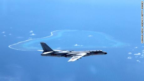A July 2016 file photo shows a Chinese H-6K bomber patrolling islands and reefs, including Huangyan Island in the South China Sea.