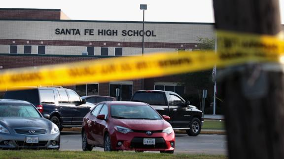SANTA FE, TX - MAY 19:  Crime scene tape is stretched across the front of  Santa Fe High School on May 19, 2018 in Santa Fe, Texas. Yesterday morning, 17-year-old student Dimitrios Pagourtzis entered the school with a shotgun and a pistol and opened fire, killing at least 10 people.  (Photo by Scott Olson/Getty Images)