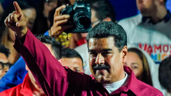 Venezuelan President Nicolas Maduro gestures after the National Electoral Council (CNE) announced the results of the voting on election day in Venezuela, on May 20, 2018. - President Nicolas Maduro was declared winner of Venezuela's election Sunday in a poll rejected as invalid by his rivals, who called for fresh elections to be held later this year. With more than 90 percent of the votes counted,  Maduro had 67.7 percent of the vote, with his main rival Henri Falcon taking 21.2 percent, the National Election Council chief Tibisay Lucena announced. (Photo by Juan BARRETO / AFP)        (Photo credit should read JUAN BARRETO/AFP/Getty Images)