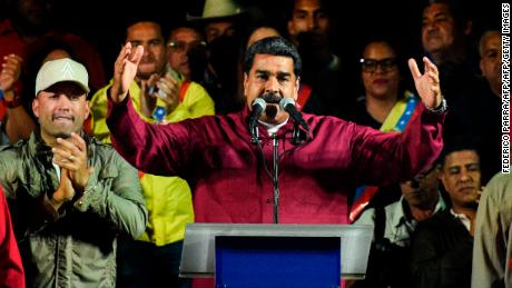 Venezuelan President Nicolas Maduro addresses supporters after the National Electoral Council (CNE) announced the results of the voting on election day in Venezuela, on May 20, 2018 in Caracas. - President Nicolas Maduro was declared winner of Venezuela's election Sunday in a poll rejected as invalid by his rivals, who called for fresh elections to be held later this year. With more than 90 percent of the votes counted, Maduro had 67.7 percent of the vote, with his main rival Henri Falcon taking 21.2 percent, the National Election Council chief Tibisay Lucena announced. (Photo by Federico PARRA / AFP)        (Photo credit should read FEDERICO PARRA/AFP/Getty Images)