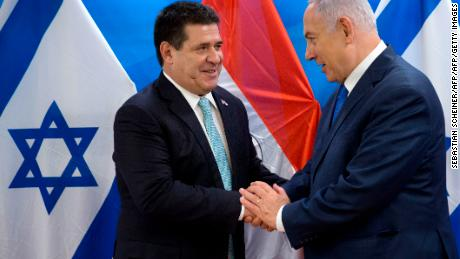 Israeli Prime Minister Benjamin Netanyahu (R) shakes hands with Paraguayan President Horacio Cartes during their meeting at the Prime Minister's office in Jerusalem on May 21, 2018. - Paraguay followed the US and Guatemala to inaugurate its new embassy in Jerusalem on May 21. (Photo by Sebastian Scheiner / POOL / AFP)        (Photo credit should read SEBASTIAN SCHEINER/AFP/Getty Images)
