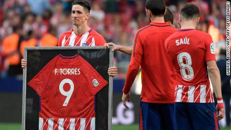 Torres was presented with a framed shirt signed by all his teammates and joined fans in a final rendition of the club's traditional anthem.