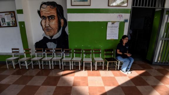 A Venezuelan woman waits at a near-empty polling station on Sunday.