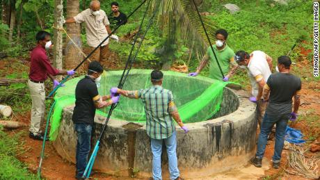 Animal Husbandry department and Forest officials inspect a well to to catch bats at Changaroth in Kozhikode in the Indian state of Kerala on May 21, 2018. - A deadly virus carried mainly by fruit bats has killed at least three people in southern India, sparking a statewide health alert May 21. Eight other deaths in the state of Kerala are being investigated for possible links to the Nipah virus, which has a 70 percent mortality rate. (Photo by - / AFP)        (Photo credit should read -/AFP/Getty Images)
