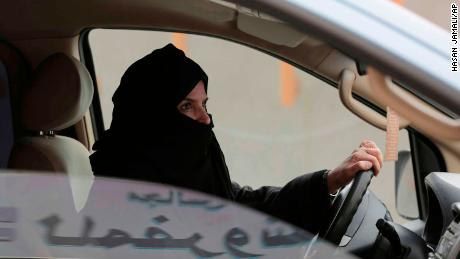 FILE - In this March 29, 2014 file photo, Aziza al-Yousef drives a car on a highway in Riyadh, Saudi Arabia, as part of a campaign to defy Saudi Arabia's ban on women driving. Saudi authorities have detained at least six activists, including three of the country's most prominent women's rights campaigners, just weeks before the kingdom is set to lift a ban on women driving, people familiar with the arrests said Friday, May 18, 2018. (AP Photo/Hasan Jamali, File)