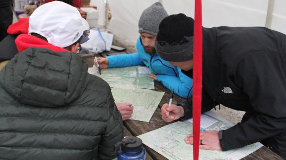 Runners must trace the course from a topographical map hours before the race begins. Four or five pages of enigmatic and wry instructions are also handed out.