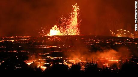 KAPOHO, HI - MAY 18:  Lava erupts and flows from a Kilauea volcano fissure on Hawaii's Big Island on May 18, 2018 in Kapoho, Hawaii. The U.S. Geological Survey said the volcano erupted explosively on May 17 launching a plume about 30,000 feet into the sky.  (Photo by Mario Tama/Getty Images)