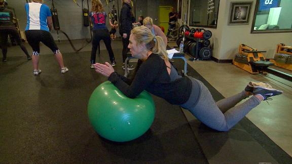 Julie Mignerey is doing a modified plank in her low impact, functional fitness class.
