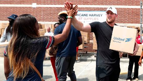 JJ Watt helps load up a car with relief supplies for Hurricane Harvey survivors in Septemner, 2017.
