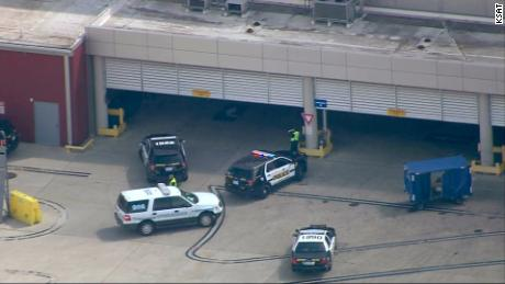 Authorities gather at the San Antonio airport, near where a baboon reportedly escaped.