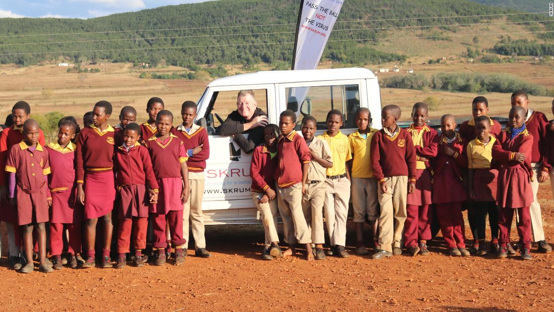 Michael Collinson (center) was paralyzed after a car accident with a bull in 2002. Five years later, after suffering for long periods from depression, he set up SKRUM in Swaziland, a charity that aims, through rugby, to educate children about HIV and Aids.