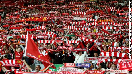 Liverpool fans cheer their team from the Kop.