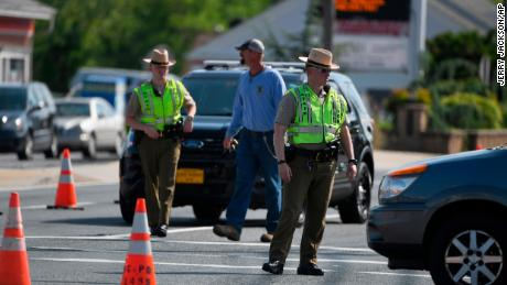 Maryland State Police divert traffic near the spot where an officer was run over Monday.