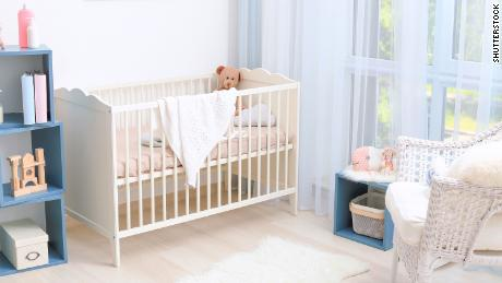 Modern interior design of baby room with crib; Shutterstock ID 674343277