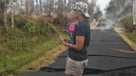 Stacy Welch surveys the cracks in road outside her home.